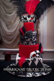 black white and red masquerade themed cake with feather accents