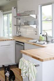 light grey kitchen cabinets with wood countertops loooove iove the shelving in place of cupboards