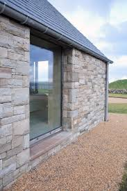stone wall house with large glass windows great country house