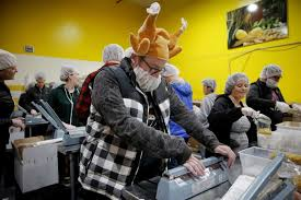 food bank volunteers offer their thanksgiving to feed the