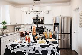black and white halloween party 10 tips for throwing a classy halloween party sandyalamode