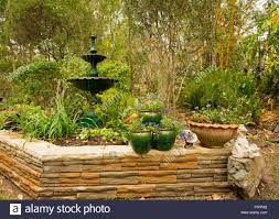 Container Water Garden Fountain Decorative Garden Feature With Low Stone Wall Ornate Fountain