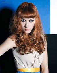 rolling hair styles 50s style for long hair with the fringe styled inward in a rolling