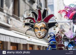 venetian carnival costumes for sale colourful jester mask for venice carnival on sale as a tourist