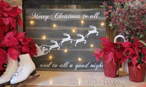 traditional christmas mantel featuring lighted santa sleigh sign
