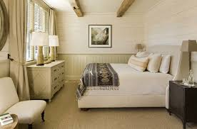 beige wainscoting bedroom rustic with beige bedding wood panel