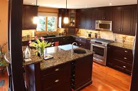 kitchen with wood cabinets gray cabinet kitchen with wooden top kitchen with dark cabinets