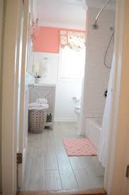 we love this bright coral colored bathroom rooms we love