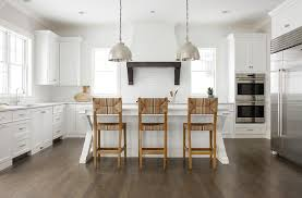 x based kitchen island with seagrass counter stools and nickel