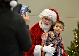 santa claus brings toys to st mary medical center for needy