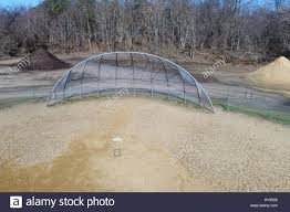 backstop and home plate on an empty baseball field stock photo