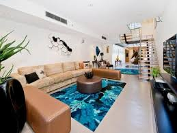 swimming pool room bachelor flat with a swimming pool in the middle of a living room