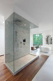 large bathroom with modern glass shower stall and freestanding tub