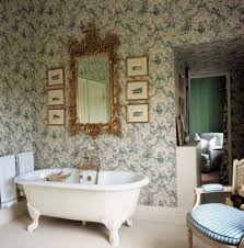 bathroom ideas rock mural bathroom wallpaper with two round floral mural bathroom wallpaper with gold carve framed mirro and small pictures above freestanding bathtub