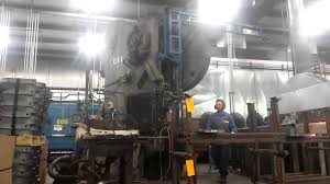 operator working a punch press youtube