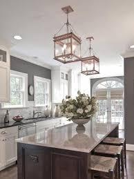 kitchen cabinets with grey walls white cabinets grey walls neutral backslash island