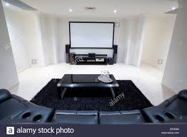 living room recliner chairs home theater room with black leather recliner chairs black rug