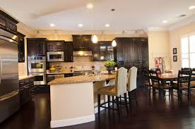 kitchen cabinets and flooring outstanding open white kitchen to dining room with dark brown wood