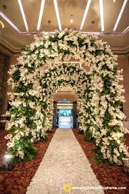 beautiful wedding gate created by lotus design with lightworks as