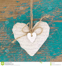 hanging heart and turquoise wooden background in country style