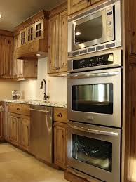 double oven and microwave and alder kitchen cabinets rustic