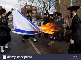Flag Burning Protest Members Of The Ultra Orthodox Jewish Anti Zionist Group The