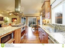 Bright Kitchen Cabinets Light Brown Kitchen Cabinets White Appliances And Hardwood Floor