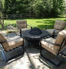 watson u0027s patio fire pit grill table and four chairs ebth