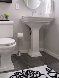 bathroom white cabinets dark floor white bath dark floor