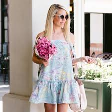 floral pastel ots dress with ruffle hem worn with wedges and open