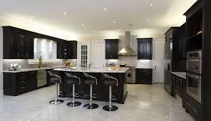 kitchen black kitchen island wall cabinet white granite countertop