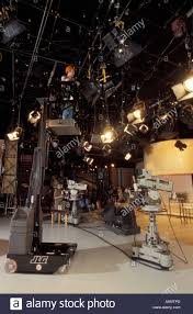 electrician on mechanical lift changes lights lighting in qvc tv