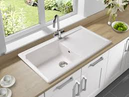 kitchen faucet leak repair kitchen faucet leaking under sink base hole white copper finishes