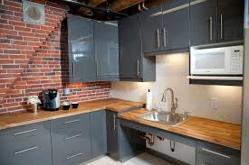 brick kitchen backsplash white kitchen cabinets with black brick