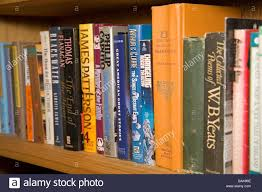 hardback books on a home library shelf include yeats and