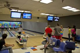 hec participants bowling inside the reitz union game room 2