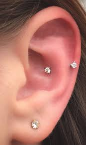 earrings all the way up different types of ear piercings the complete list