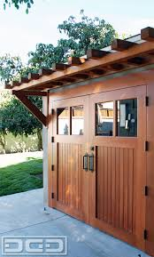 real wood carriage garage door ideas with matching overhead pergola idea over our carriage doors