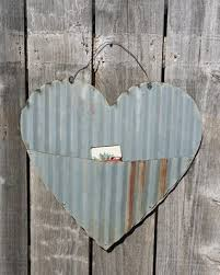 up cycled corrugated metal heart with pocket