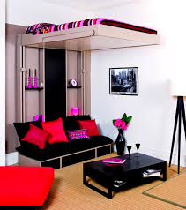 pink cushions on black fabric sofa and rectangle black wooden