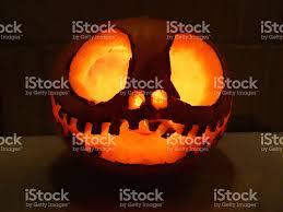 carved pumpkin head image scary halloween face candle illuminated
