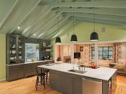 open concept farmhouse open concept kitchen catwalk stone fireplace sliding door mountain