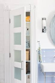 bathroom linen cabinet with glass doors frosted glass doors accent this linen closet which doubles as a