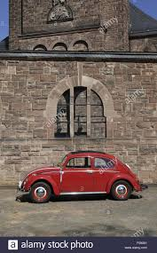 volkswagen beetle red vw beetle red car in front of parish of christ the king in stock