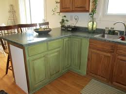 ceramic tile countertops sage green kitchen cabinets lighting