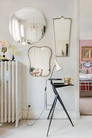 livingroom mirrors 22 tips to make your tiny living room feel bigger brit co