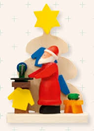 santa claus with tree and sewing machine german wood