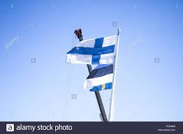 Finnish Flag Finnish Flag On A Pole In Front Of Estonian And Swedish Flag