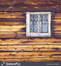 picture of wooden wall with square window