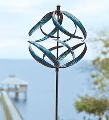 metallic blue wind spinner garden path wind